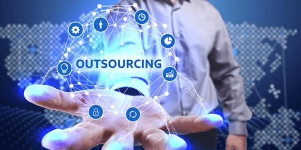 the word outsourcing floating above a man's palm of the hand.